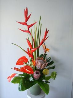 Tropical Flower Arrangment reception wedding flowers,  wedding decor, wedding flower centerpiece, wedding flower arrangement, add pic source on comment and we will update it. www.myfloweraffair.com can create this beautiful wedding flower look.