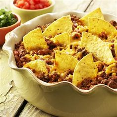 """Taco Casserole: A quick and easy one-dish version of """"Taco Night"""". All of the great flavor of tacos in one delicious dish. - super easy dinner and delish. added our fave toppings (sour cream, black olives, salsa, green onions) Taco Casserole, Casserole Dishes, Casserole Recipes, Taco Bake, Mexican Casserole, Tasty Dishes, Food Dishes, Main Dishes, Mexican Food Recipes"""