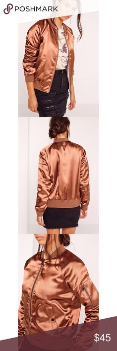 """MISSGUIDED    premium satin bomber jacket gold Brand new, without tag. In perfect condition. Featuring a space age gold hue, sleek satin feel, two pockets to the front, silver zip and rich brown lining. Approx length 62cm/24"""" (based on a uk size 8 sample)  shell, wading and lining: 100% polyester. trim: 65% polyester 33% viscose 2% elastane Model wears a uk size 8 / eu size 36 / us size 4 and her height is 5'8"""" product number: o1441694 Missguided Jackets & Coats Utility Jackets"""