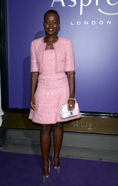 Lupita Nyong'o took on spring's pale pink trend in this classic Tweed Chanel suit