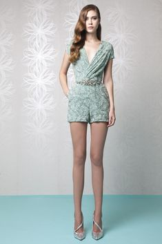 Short Aqua wrap jumpsuit in embroidered Tulle, featuring cap sleeves, a V-neckline and an embellished belt accessory.