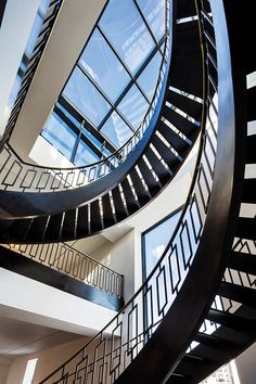 Spiral staircase in Delos penthouse apartment leads up to the roof. | #OrganicSpaMagazine #greenliving