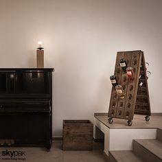 Ruchomy stojak na wino z drewna. Zobacz więcej na: https://www.homify.pl/katalogi-inspiracji/13329/pomysly-na-prezenty-dla-taty