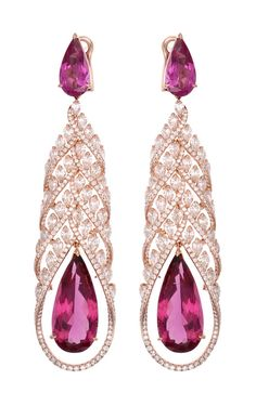 Chopard's Red Carpet Collection earrings with pear-shaped rubellites and diamonds, set in rose gold. (=)