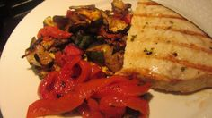 Grilled swordfish with homemade roasted peppers, eggplant, zucchini, tomatoes and basil vinagrette
