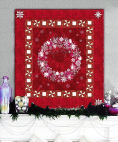 Berry red wreath and twinkling lights quilt kit/pattern at Homespun Hearth