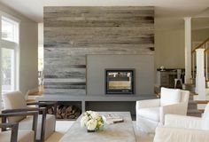 I like the weathered wood wall treatment and  the clean, open storage approach to the hearth.  Might work in our large entertainment niche.