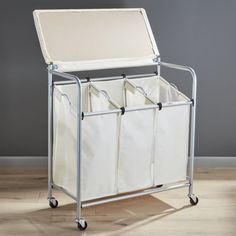 neatfreak hampers everfresh laundry triple sorter with ironing board compact ironing board. Black Bedroom Furniture Sets. Home Design Ideas