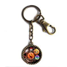 Pokemon Charizard Y Pokeball Keychain Key Chain Key Ring Cute Keyring Car Anime Charizardite Y Mega Stone Cosplay Gear Steampunk Keystone. Size:L8X3CM Pendant Size: 2.9CM Colors: Ancient bronze Material:Alloy+Glass.