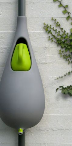 """""""Raindrop"""" rain barrel with watering can.  Can anyone find this to buy in the states? I can only find it available in Europe?  Of course!  Treehugger.com"""
