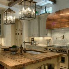Island love--- great copper hood, hardware and lanterns oh my!