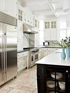coffered ceilings, paneled cabinets, subway tile