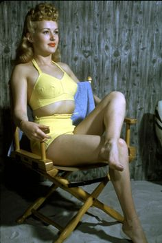 We love the bright acid yellow of actress Betty Grable's bathing suit. So on trend. And. That. HAIR.