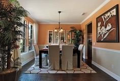 Traditional Dining Room with Crown molding, Chair rail, Hardwood floors, Pendant light, Carpet