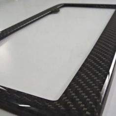 Carbon Fiber License Plate Frame at the Shopping Mall, $45.00 (USD)