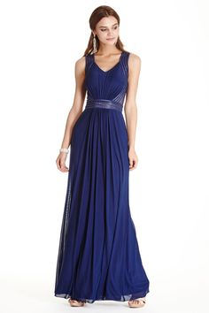 Formal Gown APL1797.  Full Length A-line Formal Evening Gown has Sleeveless Bodice with Ruched Front, V Neck and Rhinestone Embellished Sheer Inserts at Waistline and Back. Solid Color Chiffon Skirt Completes the Style with Elegance.  https://www.dresstopic.com/evening-dresses/formal-gown-apl1797