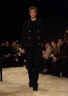 The Military Topcoat in navy felted wool, worn over mohair and wool wide-leg trousers
