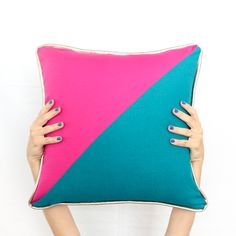 Learn how to sew your own colorblocked triangle pillows with gold piping detail - how to sew - sewing a pillow - fall pillows - jewel tones - sewing - adding piping to pillows - diy - how to - target throw pillows