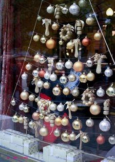 Original idea for a christmas tree in the window (or even the shop) but instead of having just ornaments it'd be fun to hang jewellery instead!