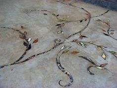 Want to get rid of ugly cracks in your old concrete driveway for ever? Let me turn your driveway into a piece of art with marble mosaic.