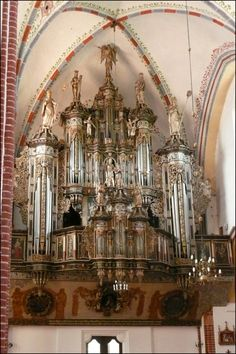 This fancy baroque organ case almost defies description because my mouth is hanging open.  At first glance you hardly even see the organ pipes.  As much as I love baroque organs, it seems too much.