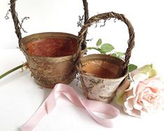 Choose from two sizes of our rustic flower girl basket for your bohemian wedding - works for barn weddings and farmhouse chic settings. Our birch flower girl baskets are made of sturdy birch bark, and a willow vine handle distressed to perfection. Small flower girl basket: 4.5 round and 7-inches tall Large flower girl basket: 7 round and 10-inches tall Our birch bark vases, baskets and bowls are rustic. Bark colors vary. They are not designed to hold water. If youd like to use them as a…