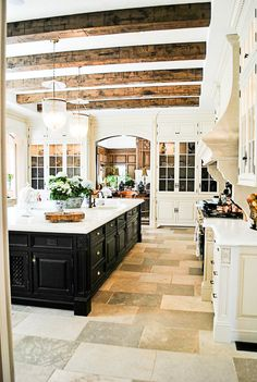 Gorgeous Kitchen with Wood Beams. So much workspace and storage! A dream!