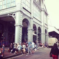 People hanging out outside of Borough Market's famous facade