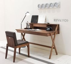 Navarra Riva 1920  This writing desk is entirely made of solid wood. The dresser over the top includes two small drawers, storage units and an upper counter top so to make the most out of available spaces. The surface is also provided with a functional cable hole. Beneath the writing surface the table features three small drawers (upon request, it is also available with one single drawer with metal slides).  http://www.martinelstore.com/en/prod/office/office-desks/navarra-riva-1920.html