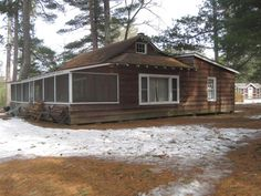 MLS # 148345 - NEW Listing! Vintage traditional old time lake cottage with 2 bedrooms bath and a half eat in kitchen big living room with stone fireplace and a full screen porch along the full face of the cottage at lakeside. This cottage was the main lodge of the resort so many years ago and has been the most popular rental over the years. The site is ideal for your dream lake home building site and is located on the fabulous Manitowish Chain of Lakes. Seller is motivated to sell.