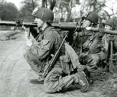 ABN American Airborne soldier in 1945 with a M18 57mm recoilless rifle, Germany. (Photo- Robert Capa)