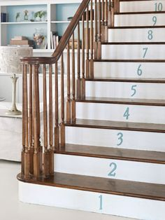 Brass house numbers from Home Depot, wearing leftover aqua paint, bring wit to the stair risers in this North Carolina home. Painted Stair Risers, Aqua Paint, Balustrades, North Carolina Homes, House Numbers, Door Numbers, Do It Yourself Home, Creative Decor, Decorating On A Budget