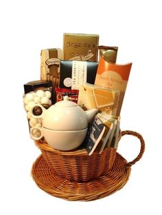 gift idea: assorted teas with teapot, spiced pecans and almonds wrapped in tea cups, good chocolate in patterned tea towels.