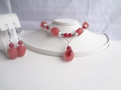 Check out this item in my Etsy shop https://www.etsy.com/listing/290719197/cherry-quartz-white-coral-necklace-with