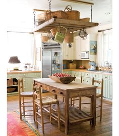 A Classic Country Kitchen  In this kitchen, sage and cream cabinetry is paired with butcher-block countertops and a marble backsplash.    Read more: Kitchen Decorating Pictures - Decorating Ideas for Kitchen - Country Living