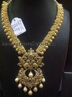 Jewellery Designs: 90 Grams Gold Swirls Long Set