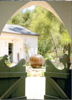 Note the dog and cat carved into these original gates at Reese Witherspoon's Ojai ranch house.