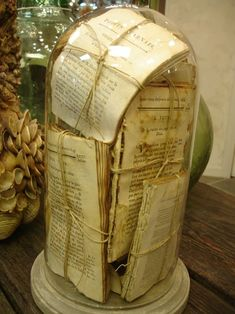 antique glass #cloche  old and tattered French book pages bundled and displayed in a cloche.