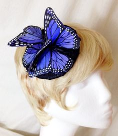 A personal favorite from my Etsy shop https://www.etsy.com/listing/236314332/purple-and-black-feather-monarch