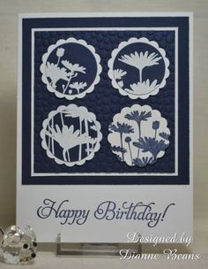 handmade birthday card ... block of four circles with different sections of the Upsy Daisy stamp ... navy and white  ... like the crisp look ...  Stampin' Up!