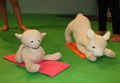 Stuffed animals used as examples in preschool yoga