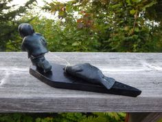 A personal favorite from my Etsy shop https://www.etsy.com/ca/listing/463981256/inuit-eskimo-art-soapstone-carving-of-a