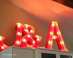 DIY Marquee Letters — all you need is foam board, poster board, paint, and a few lights.