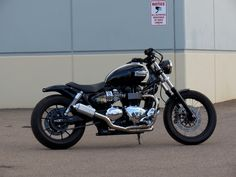 Another Triumph America bobber.  Not sure about the rear fender, pipes, or tank, but like the lines.