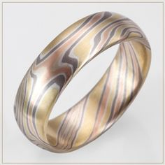 Maui Sunset Mokume Gane Wedding Ring. This is so cool! I've never seen anything like this.