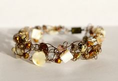 Sand & Shell Knitted bracelet - rustic and beachy wire knit bracelet with cream shell, golden pearls, smoky Quartz and Dalmatian Jasper