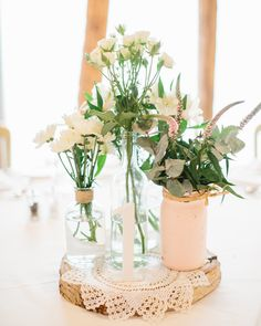 Our table centre pieces included a Silver Birch tree slice, a cotton doilie, four different types of glass jars and a painted wooden table number.