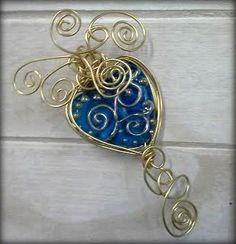 Hand- made lampwork heart from Sally  Shepherd Bell and wirewrapped by me in non-tarnish goldplate wire.