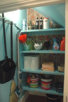beautifully organised under stairs cupboard