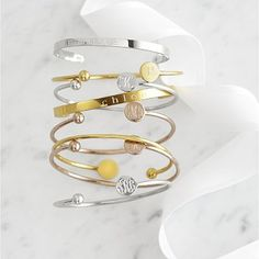 I love the Elle Bangle on markandgraham.com     Bangles with my babys initials. I want one with a W!